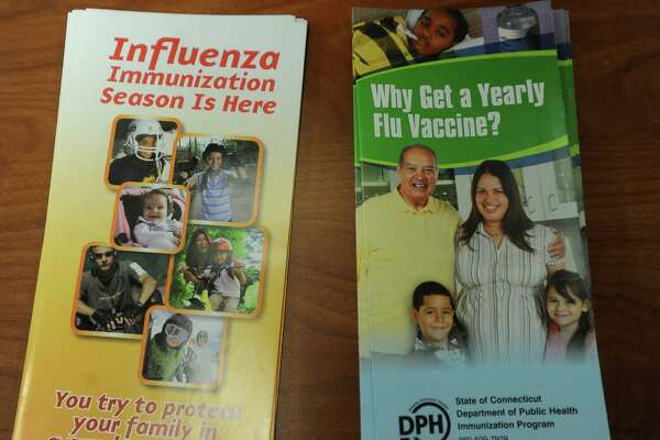 Flu vaccine brochures at the free flu shot clinic at Milford Health Department offices in Milford, Conn. on Wednesday, January 24, 2018.