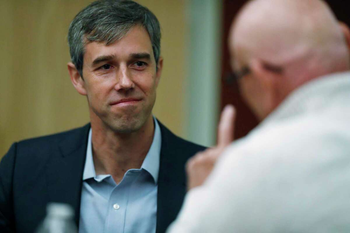U.S. Rep. Beto O'Rourke, D-Texas, left, listens as Lonnie Phillips, who lost his daughter in the mass shooting at a movie theatre in Aurora, Colo., in 2012, speaks during a roundtable discussion about the issues of gun control and the need for additional mental health measures at an office Friday, Sept. 20, 2019, in downtown Denver. (AP Photo/David Zalubowski)