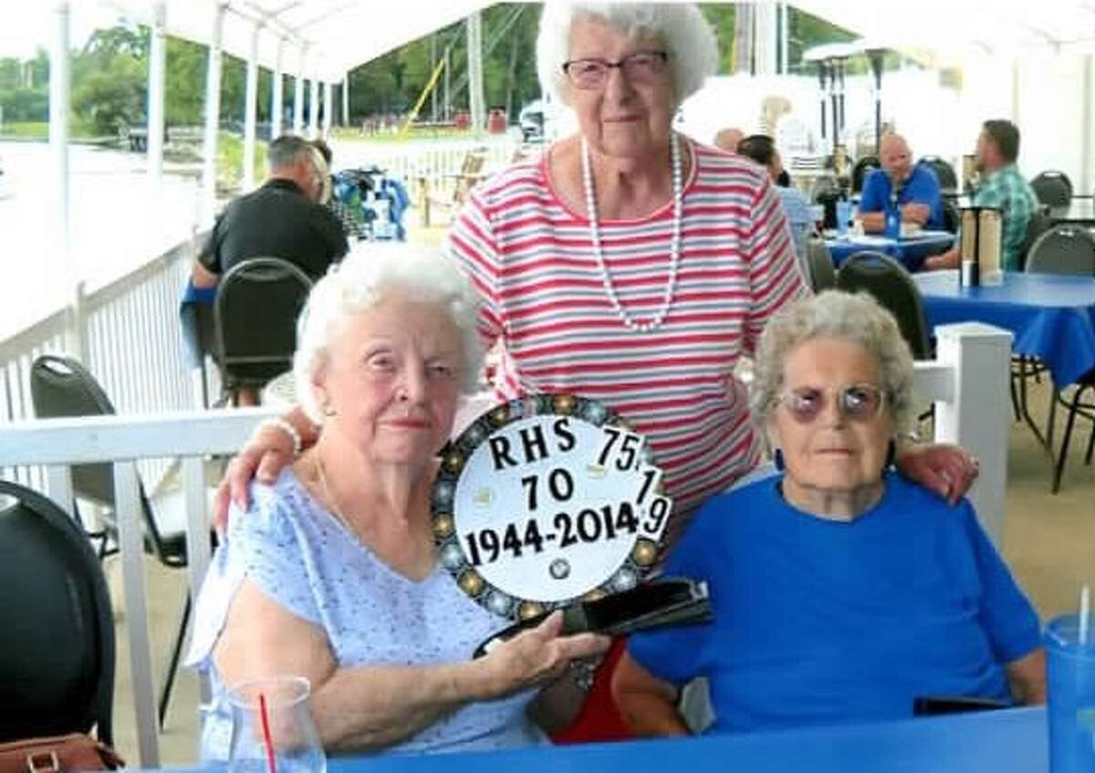 Three of the last remaining members of Ravena High School's Class of 1944 attend their 75th reunion luncheon at Yanni's Too Restaurant in Ravena on Aug. 16. From left, Austa (Dopp) Cole, 93, of Ravena, Marion (Covey) Fazzone, 91, standing of Colonie and Pauline (Court) Van Etten, 92, of Ravena. Mrs. Fazzone says that to their knowledge, other than one person living in a nursing home, these are the only local people living from that class. Two or three others may be living in other states. She said that the 1944 class was the last one to graduate from the school before it closed and became Ravena-Coeymans in 1945. (Photo provided)