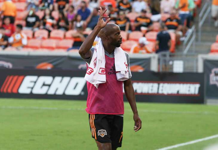 Houston Dynamo midfielder DaMarcus Beasley (7) waves as he is welcomed by the fans before the MLS game against the Seattle Sounders at BBVA Stadium on Saturday, July 27, 2019, in Houston.