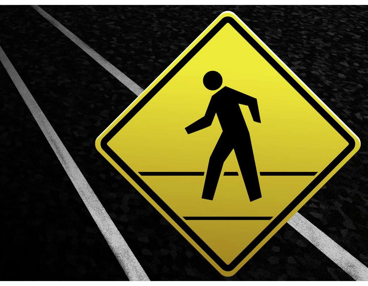 300 dpi 3 col. x 5 inches/164x127 mm/558x432 pixels Kurt Strazdins color illustration of a pedestrian crossing warning sign with street as background. KRT 2000 Companion KRT News in Motion animations are available on this subject.