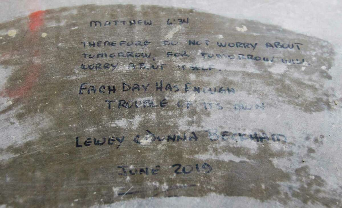 A Bible passage from Matthew 6:34 is seen written on the floor of Lewey Beckham's home from when his and his wife were repairing their home in Elm Grove after it flooded four months ago, Friday, Sept. 20, 2019, in Kingwood.