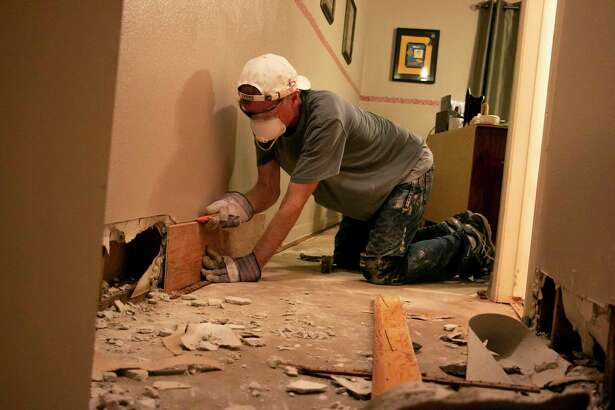 John Raney with Second Baptist Church volunteered to tear out drywall where water flooded John Bogert's house in Elm Grove. Bogert said he had 3 to 4 inches of water standing in his house for hours.