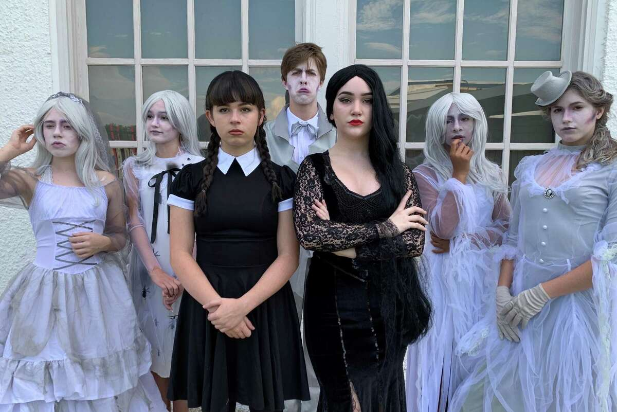 Morticia (Lizzie Tyer) and Wednesday (Madison Willett) Addams are joined by some of their haunting ancestors. Inspiration Stage will present