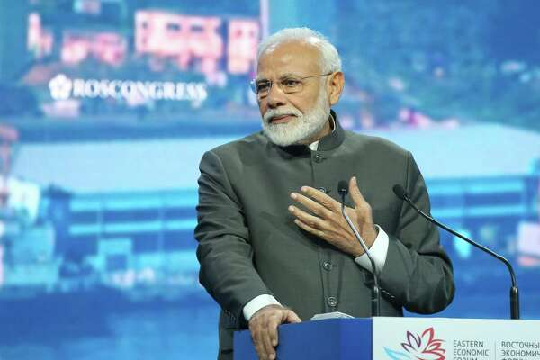 "Narendra Modi, India's prime minister, gestures as he speaks during a plenary session on day two of the Eastern Economic Forum in Vladivostok, Russia. Modi will be in Houston this weekend for the 'Howdy, Modi!"" event at NRG Staidum."