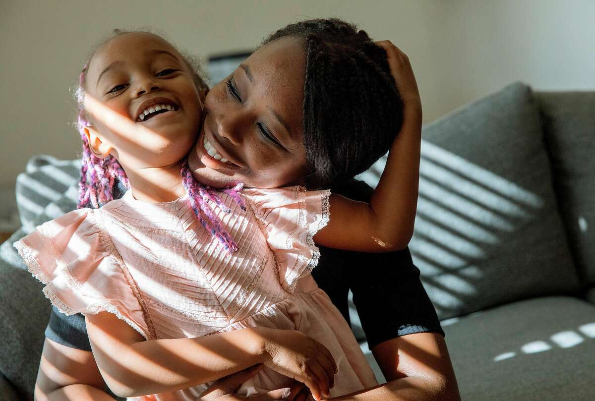 Cassandra Trimnell, 31, sits on the couch with her daughter Zahra, 5, while at home in San Jose, Calif. Friday, September 20, 2019. Trimnell lives with sickle cell disease and founded a non-profit to promote awareness of sickle cell.
