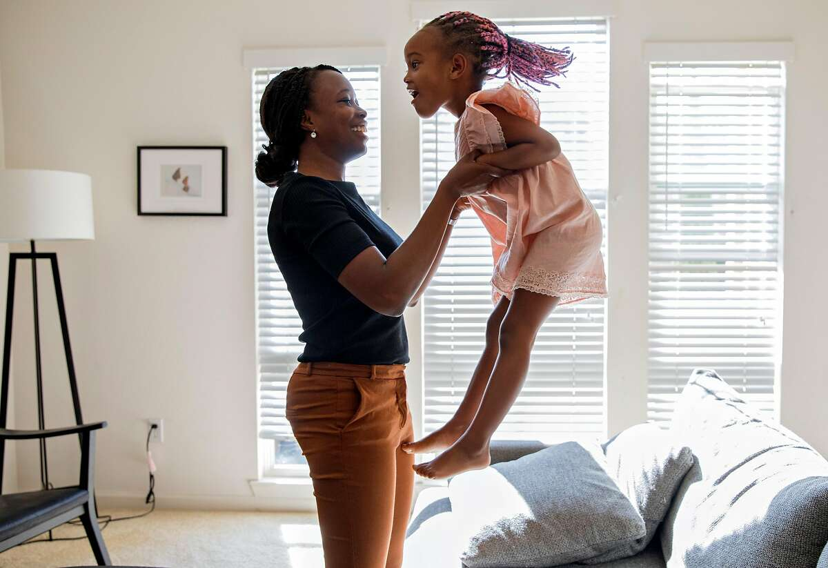 sickle0923Cassandra Trimnell, 31, laughs as her daughter Zahra, 5, jumps on the couch at their home in San Jose, Calif. Friday, September 20, 2019. Trimnell lives with sickle cell disease and founded a non-profit to promote awareness of sickle cell.