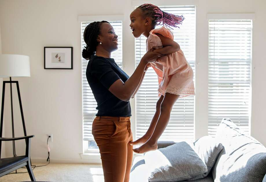 Cassandra Trimnell, 31, laughs as her daughter Zahra, 5, jumps on the couch at their home in San Jose, Calif., on Friday, September 20, 2019. Trimnell lives with sickle cell disease and founded a non-profit to promote awareness of sickle cell. Photo: Jessica Christian / The Chronicle