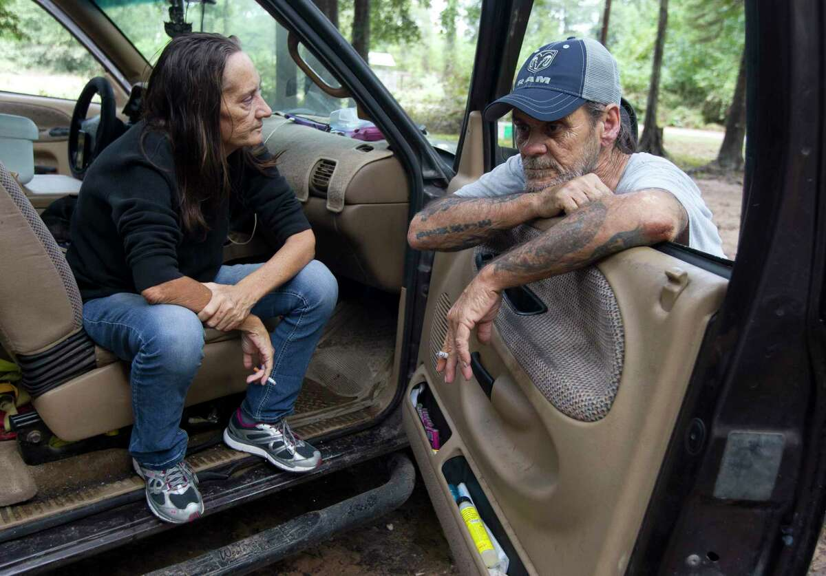 """Margret Cameron takes in a moment beside her fiancé, Bennie Lee, after returning to her home after it was flooded with five and a half feet of water from Tropical Depression Imelda, Friday, Sept. 20, 2019, in Splendora. Margret, Bennie and his daughter have stayed in their truck a few houses down for the last two days. """"We rebuild, come back, rebuild and come back,"""" Bennie Lee said. """"You just start to wonder what's the point after a while."""""""