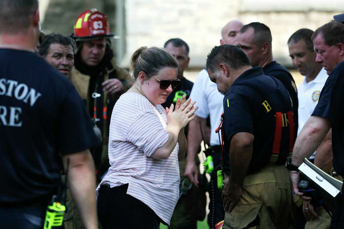 St. Mark's United Methodist Church Pastor Emily Chapman talks to members of the Houston fire department on Friday, Sept. 20, 2019.