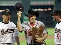 Atlanta Braves manager Bobby Cox, center, tips his cap after being presented a cowboy hat and a pair of boots by Houston Astros manager Brad Mills, left, and hitting coach Jeff Bagwell, right, before a baseball game Tuesday, Aug. 10, 2010 in Houston. (AP Photo/David J. Phillip)