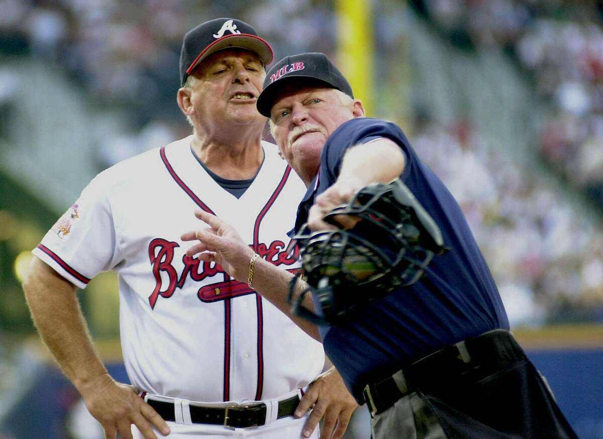 Atlanta Braves manager Bobby Cox, left, continues to yell at home plate umpire John Shulock as Shulock ejects Cox in the first inning against the Milwaukee Brewers on Saturday, June 24, 2000, at Turner Field in Atlanta. Cox was arguing a catcher's balk call on Fernando Lunar. (AP Photo/Erik S. Lesser)