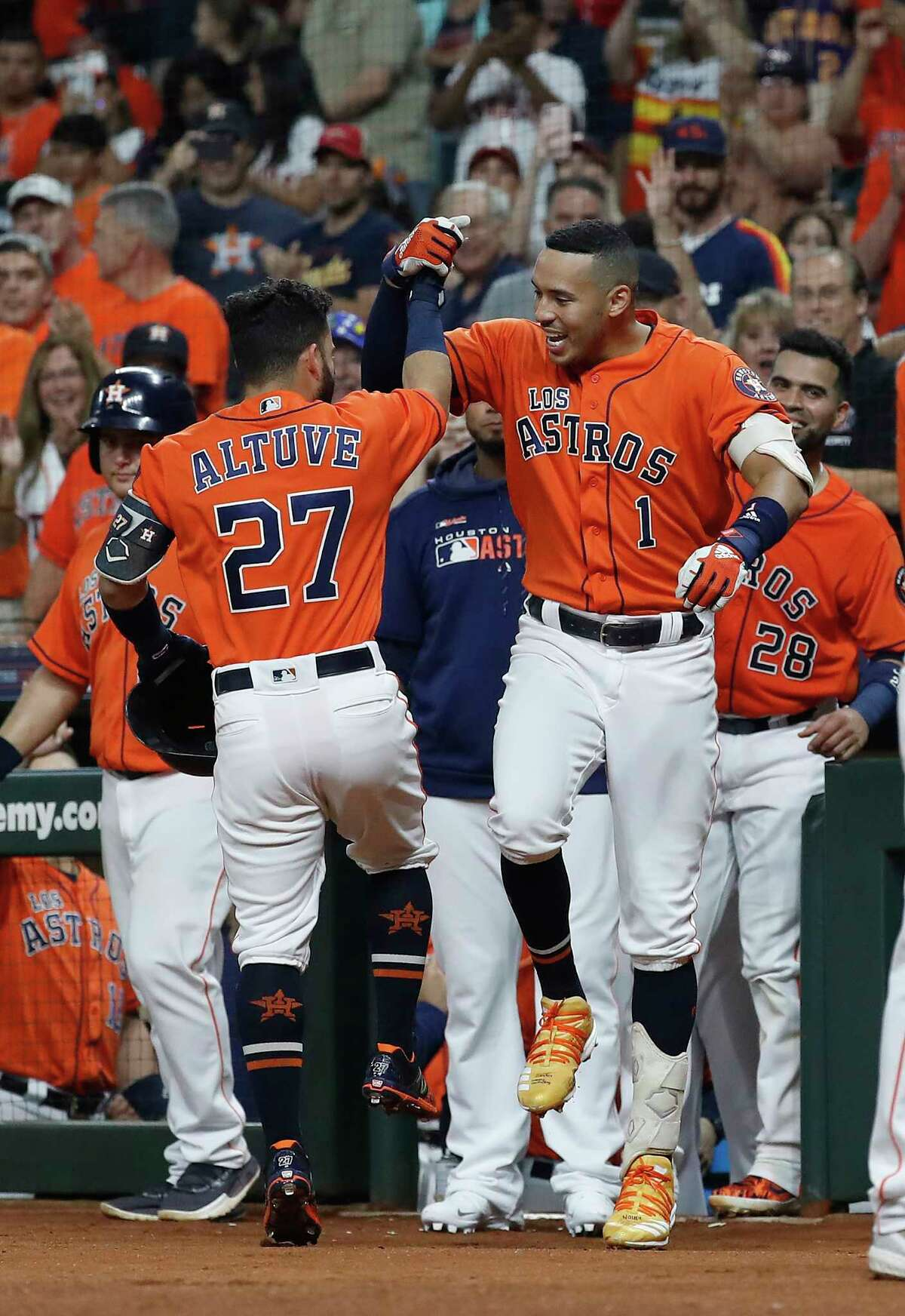 Houston Astros Jose Altuve (27) celebrates his home run with Carlos Correa (1) during the first inning of an MLB baseball game at Minute Maid Park, Friday, Sept. 20, 2019, in Houston.