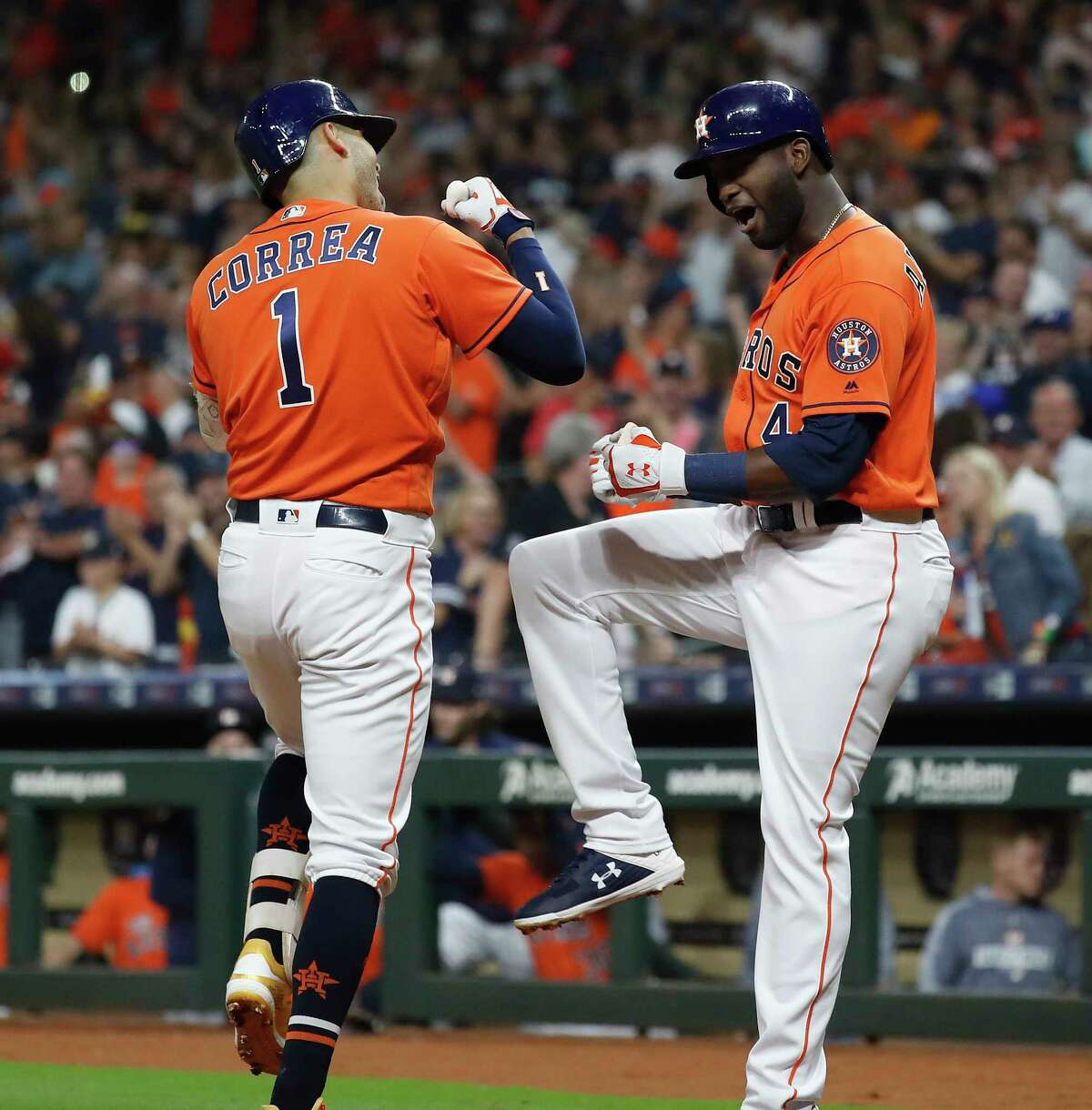 Houston Astros Carlos Correa (1) celebrates his home run with Yordan Alvarez (44) during the first inning of an MLB baseball game at Minute Maid Park, Friday, Sept. 20, 2019, in Houston.