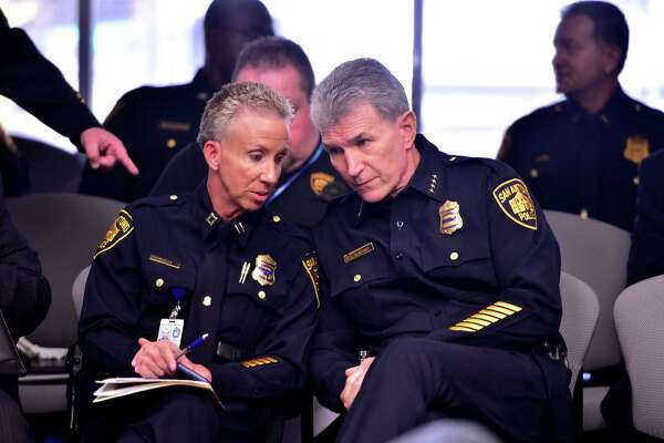 Police Chief William McManus, right, confers with Capt. Karen Falke on Sept. 20, 2019, prior to briefing the City Council's public safety committee about an overall 16 percent decrease in major crimes in San Antonio.