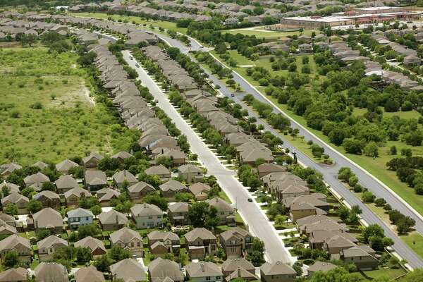 Recently built subdivisions are seen Wednesday, May 23, 2018 near Culebra Road outside Loop 1604 on the city's expanding west side.