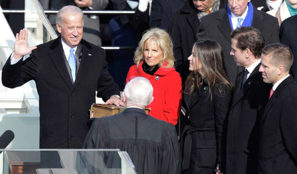 Then-Vice President-elect Joe Biden, with his wife Jill at his side, takes the oath of office at the U.S. Capitol in Washington, D.C. on Tuesday, Jan. 20, 2009.