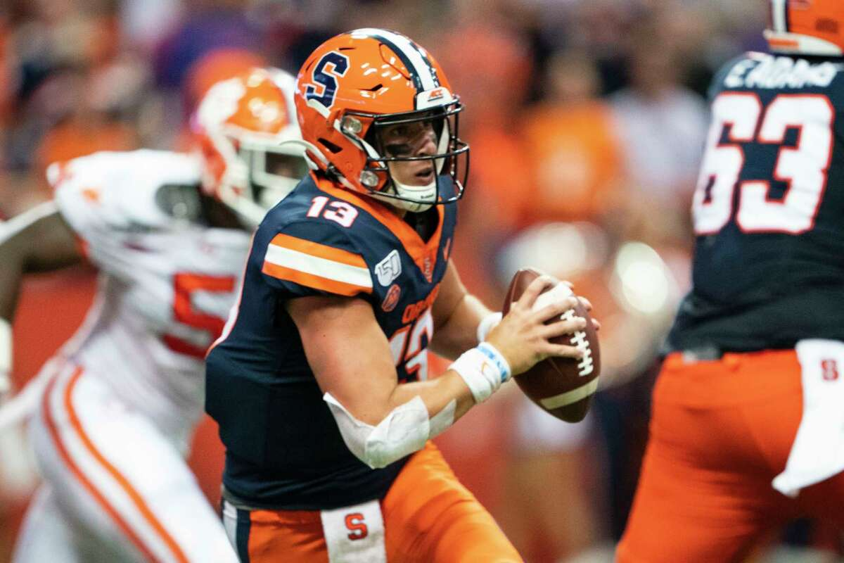 SYRACUSE, NY - SEPTEMBER 14: Syracuse Orange Quarterback Tommy DeVito (13) scrambles during the second quarter of the game between the Clemson Tigers and the Syracuse Orange on September 14, 2019, at the Carrier Dome in Syracuse, NY. (Photo by Gregory Fisher/Icon Sportswire via Getty Images)