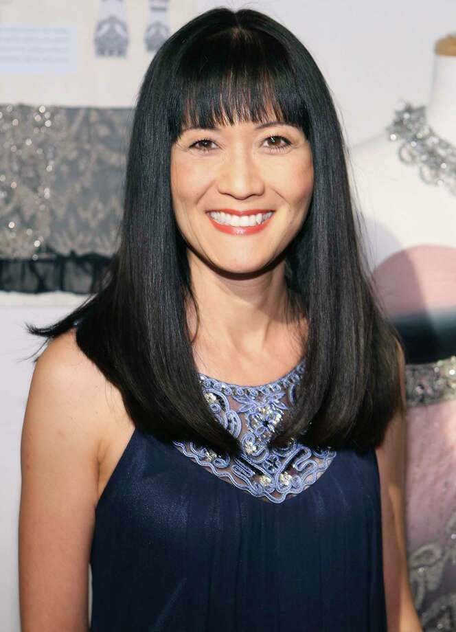 "FILE - In this March 6, 2010 file photo, Suzanne Whang attends the Sue Wong Fall 2010 Preview, in Los Angeles. Whang, whose smooth, calm voice provided the narration for HGTV's ""House Hunters"" for years, died Tuesday, Sept. 17, 2019. She was 57. (Shea Walsh / AP Images for Sue Wong, File) Photo: Shea Walsh / AP"