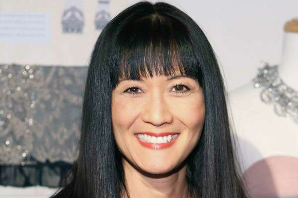 "FILE - In this March 6, 2010 file photo, Suzanne Whang attends the Sue Wong Fall 2010 Preview, in Los Angeles. Whang, whose smooth, calm voice provided the narration for HGTV's ""House Hunters"" for years, died Tuesday, Sept. 17, 2019. She was 57. (Shea Walsh / AP Images for Sue Wong, File)"