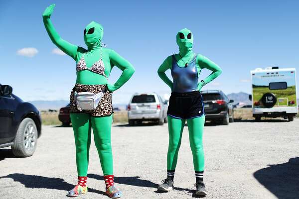 RACHEL, NEVADA - SEPTEMBER 20: Women are dressed as aliens at a 'Storm Area 51' spinoff event called 'Alienstock' on September 20, 2019 in Rachel, Nevada. The event is a spinoff from the original 'Storm Area 51' Facebook event which jokingly encouraged participants to charge the famously secretive Area 51 military base in order to 'see them aliens'. Two tiny desert towns not far from from the once-secret Area 51 are hosting related events this weekend. The military has warned attendees not to approach the protected Area 51 military installation. (Photo by Mario Tama/Getty Images)