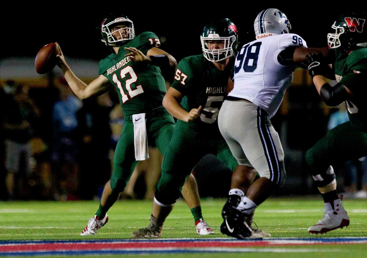 The Woodlands quarterback Ben Mills (12) drops back to pass during the second quarter of a District 15-6A high school football game at Woodforest Bank Stadium, Friday, Sept. 20, 2019, in Shenandoah.