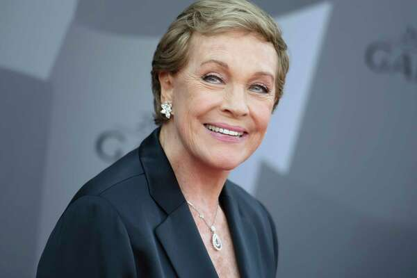 FILE - In this Sept. 29, 2015 file photo, actress Julie Andrews arrives at the Los Angeles Philharmonic 2015/2016 season opening gala at Walt Disney Concert Hall in Los Angeles. The American Film Institute is honoring Andrews with a Life Achievement Award. The organization said Friday, Sept. 20, 2019, that Andrews will receive the award at the Gala Tribute on April 25, 2020, in Los Angeles. (Photo by Richard Shotwell/Invision/AP, File)