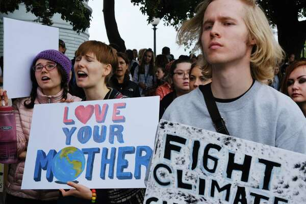 An estimated 10,000 demonstrators, led by students and youth, rallied at Cal Anderson Park and then made their way to Seattle City Hall, meeting up with a second group of protesters--mostly tech workers coming from the Amazon Spheres--along the way, as a part of a global Climate Strike, and calling for local and national leaders to do more to address climate change, Friday, September 20, 2019.