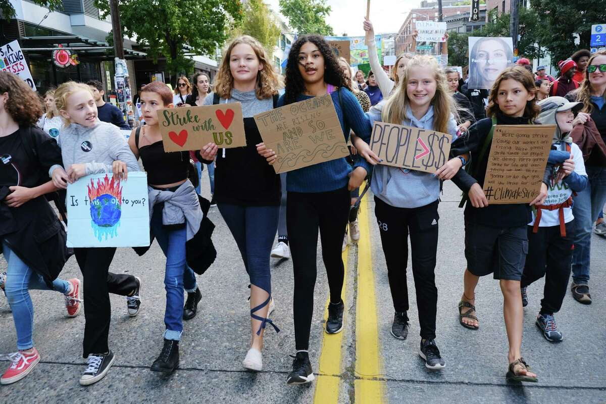 Students from Salmon Bay School march as an estimated 10,000 demonstrators, led by students and youth, rallied at Cal Anderson Park and then made their way to Seattle City Hall, meeting up with a second group of protesters--mostly tech workers coming from the Amazon Spheres--along the way, as a part of a global Climate Strike, and calling for local and national leaders to do more to address climate change, Friday, September 20, 2019.