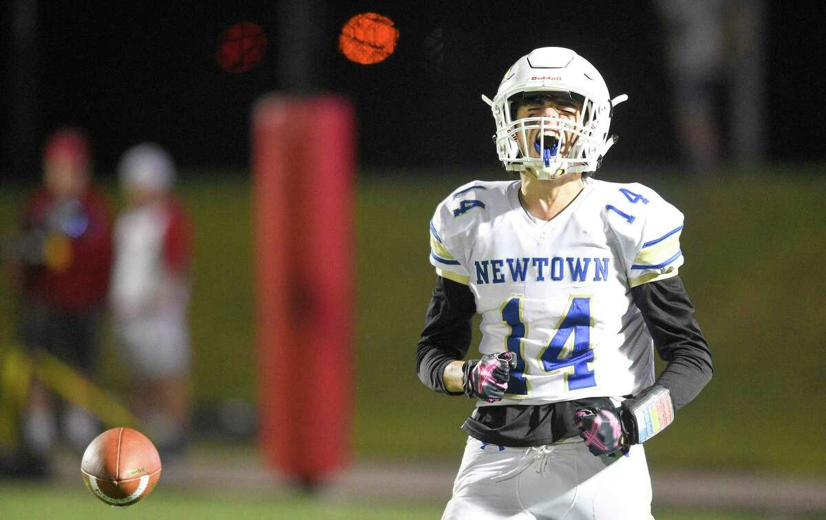 Newtown's CJ Cuomo celebrates a first down reception against Fairfield Prep in the second half the Nighthawks' 21-14 victory at Rafferty Stadium in Fairfield, Conn. on Friday.