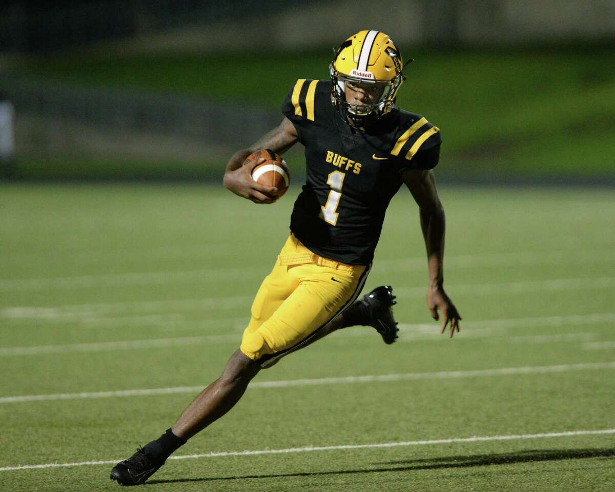 Malik Hornsby (1) of Marshall carries the ball for a touchdown on a quarterback keeper during the second quarter of a District 11-5A Div II football game between the Manvel Mavericks and the Marshall Buffalos on Friday, September 20, 2019 at Hall Stadium, Missouri City, TX.