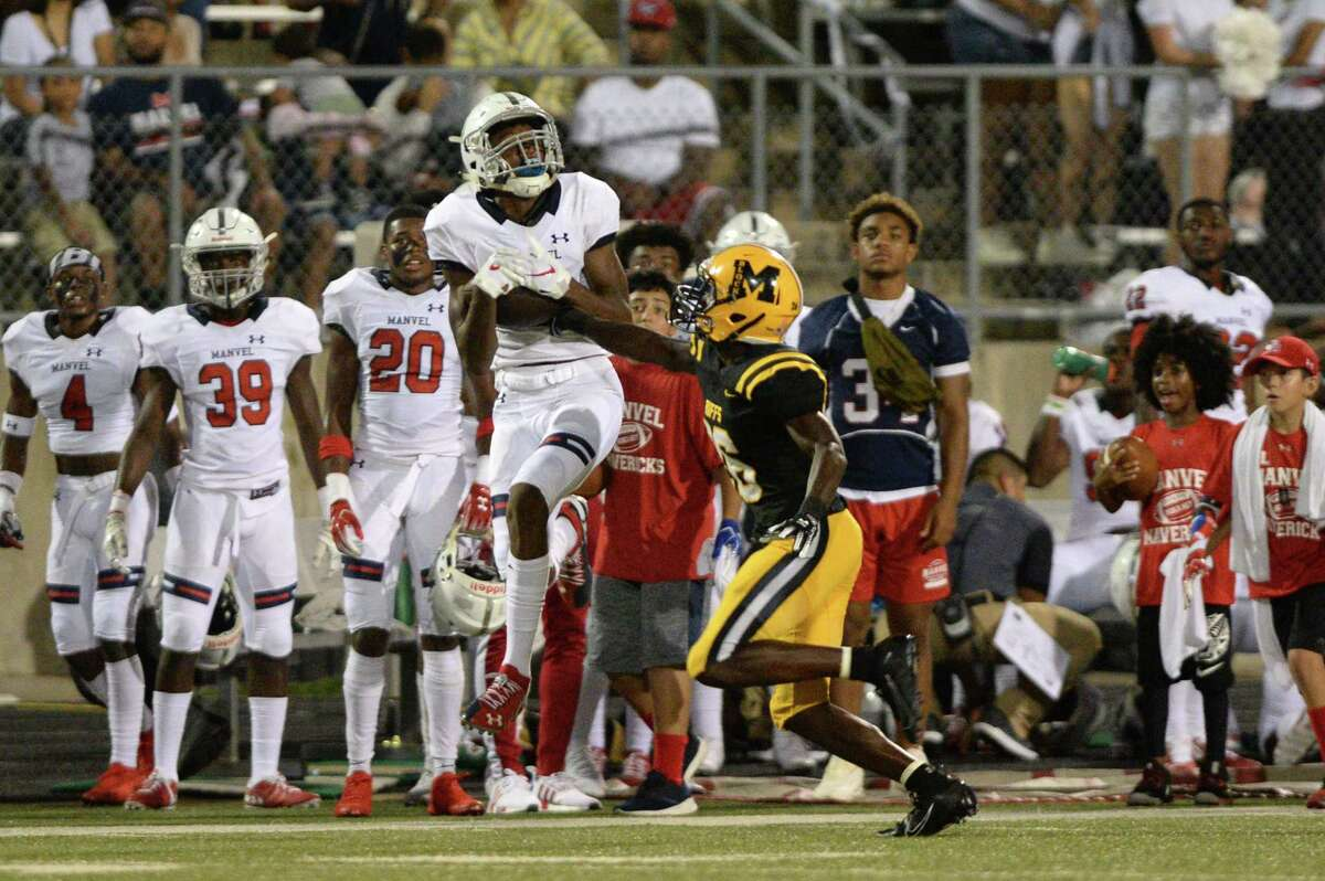 Jalen Walthall (3) of Manvel makes a reception during the second quarter of a District 11-5A Div II football game between the Manvel Mavericks and the Marshall Buffalos on Friday, September 20, 2019 at Hall Stadium, Missouri City, TX.