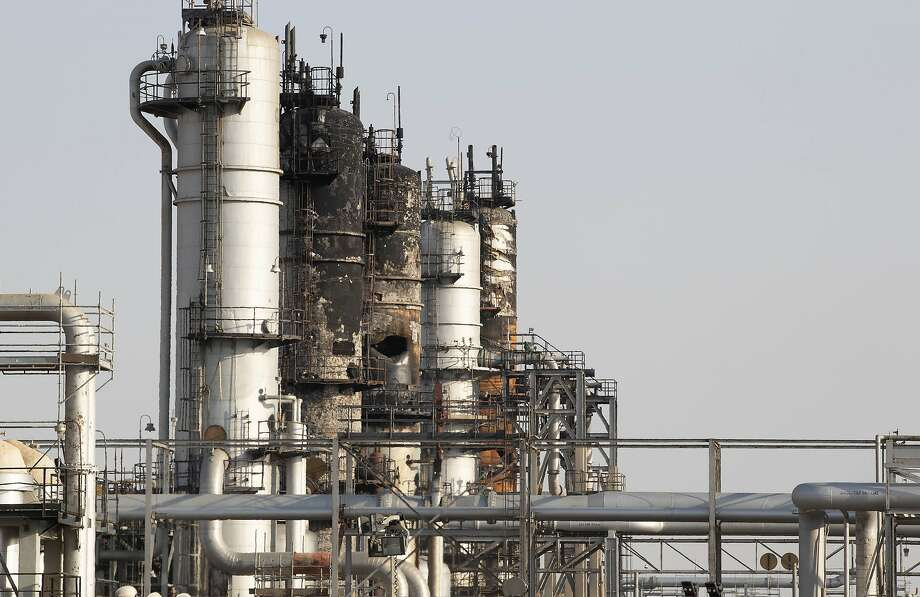Damaged refining towers stand during repair work at Saudi Aramco's Abqaiq crude oil processing plant following a drone attack in Abqaiq, Saudi Arabia, on Friday, Sept. 20, 2019. Saudi Aramcorevealed the significant damage caused by an aerial strike on its Khurais oil field and Abqaiq crude-processing plant last weekend, and insisted that the sites will be back to pre-attack output levels by the end of the month. Photographer: Faisal Al Nasser/Bloomberg Photo: Faisal Al Nasser, Bloomberg