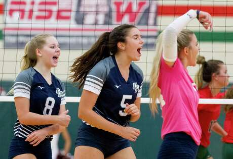 FILE PHOTO — College Park middle blocker Abby Kremer (5) reacts after scoring a point beside right side hitter Mallory Madison (8) and libero Caley Caffey (24) during the first set of a District 15-6A high school volleyball match at The Woodlands High School, Tuesday, Sept. 3, 2019, in The Woodlands.