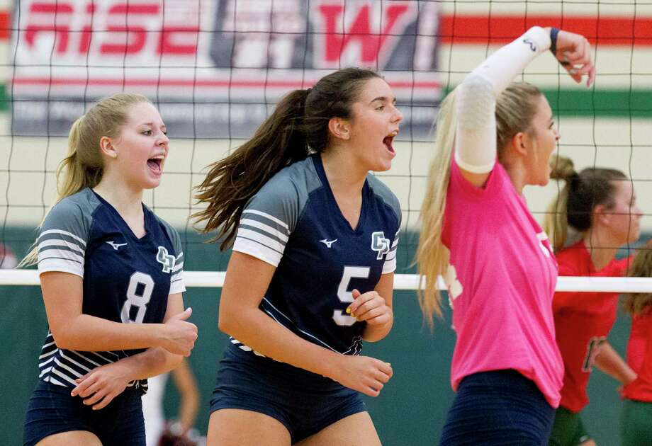 FILE PHOTO — College Park middle blocker Abby Kremer (5) reacts after scoring a point beside right side hitter Mallory Madison (8) and libero Caley Caffey (24) during the first set of a District 15-6A high school volleyball match at The Woodlands High School, Tuesday, Sept. 3, 2019, in The Woodlands. Photo: Jason Fochtman, Houston Chronicle / Staff Photographer / Houston Chronicle