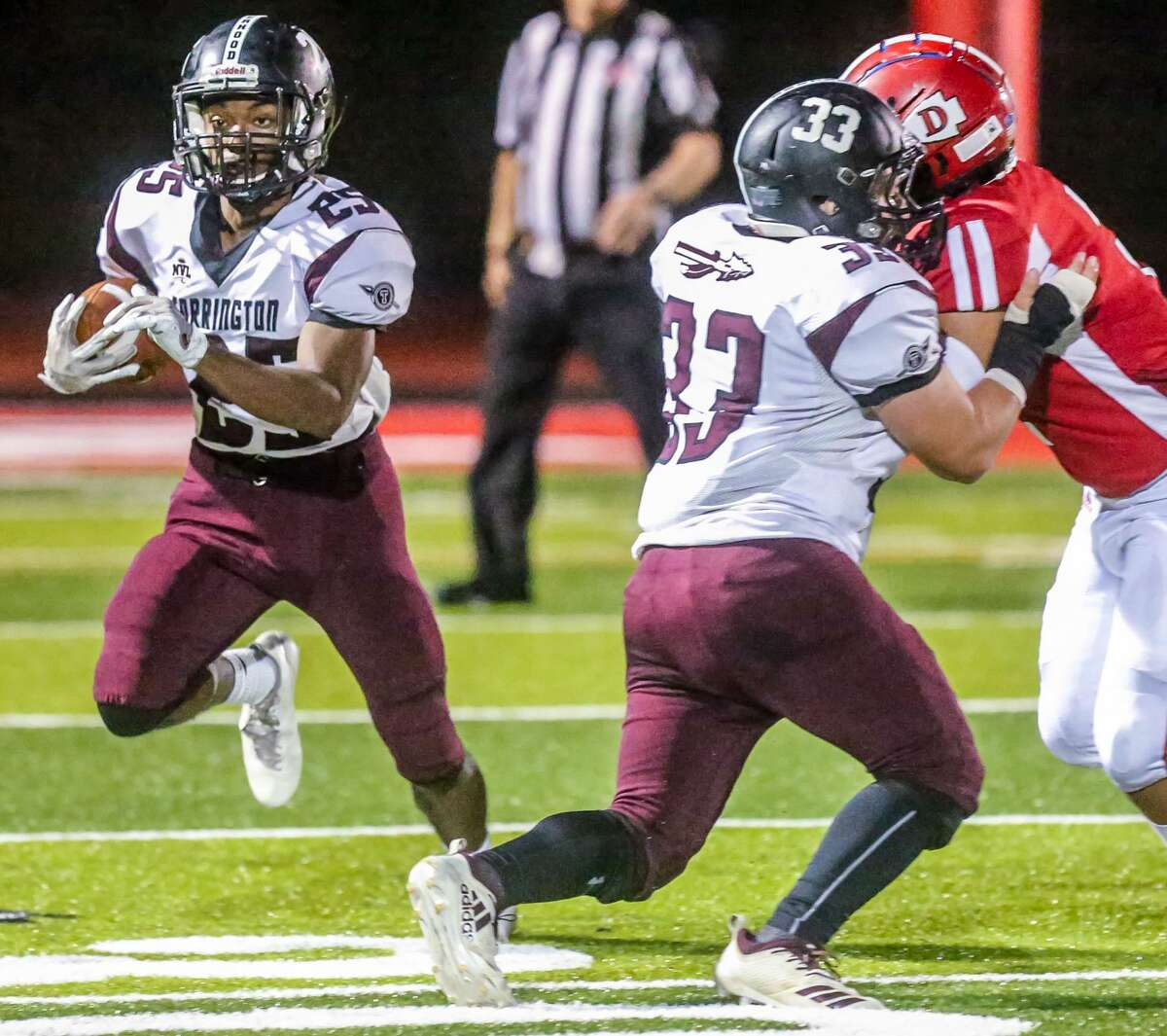 (John Vanacore/For Hearst Connecticut Media) The Red Raiders of Derby played host to the Red Raiders of Torrington Friday, Septermber 20, 2019. The game was the first under the lights on the all new DeFillipo Field.
