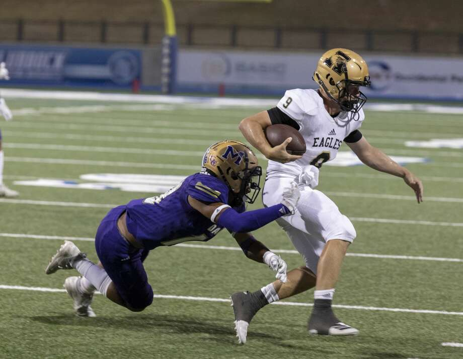 Midland High's Brannan Mannix tackles Abilene High's Matthew Ezzell (9) on Friday, Sept. 20, 2019 at Grande Communications Stadium. Photo: Jacy Lewis/Reporter-Telegram
