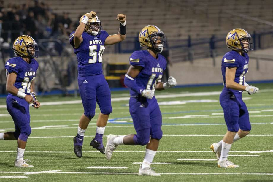 Midland High's Mauro Sanchez (50) celebrates after tackling Abilene High's quarterback Friday, Sept. 20, 2019 at Grande Communications Stadium. Photo: Jacy Lewis/Reporter-Telegram