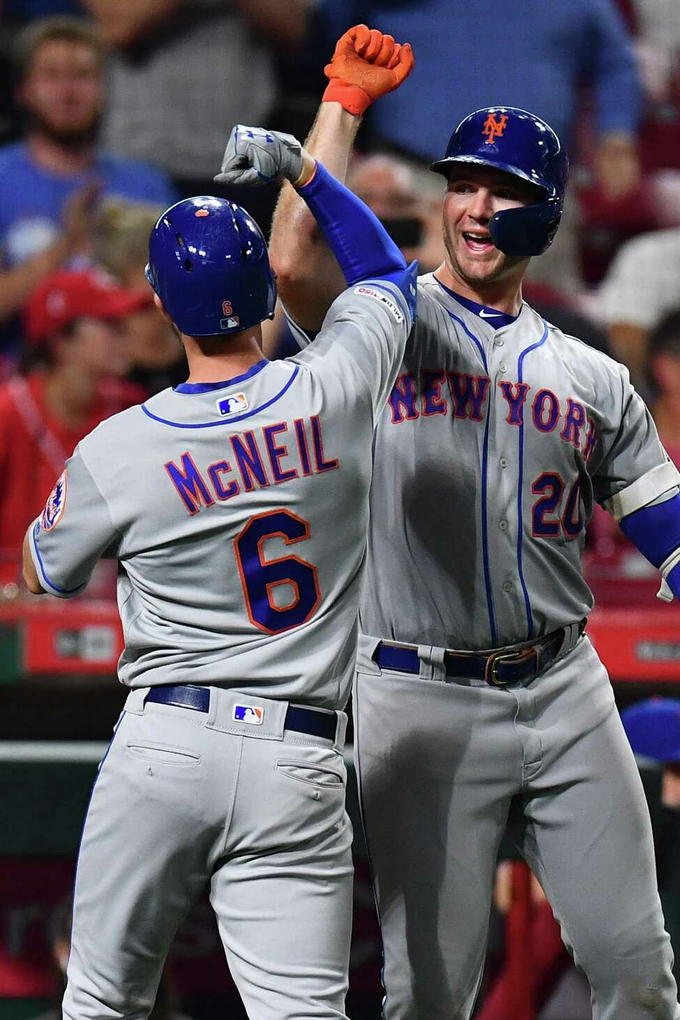 CINCINNATI, OH - SEPTEMBER 20: Pete Alonso #20 of the New York Mets celebrates with Jeff McNeil #6 of the New York Mets after McNeil hit a home run in the sixth inning against the Cincinnati Reds at Great American Ball Park on September 20, 2019 in Cincinnati, Ohio. New York defeated Cincinnati 8-1. (Photo by Jamie Sabau/Getty Images)