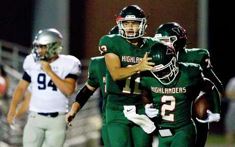 The Woodlands running back Malik Johnson (2) react with quarterback Ben Mills (12) after the two connected for a 25-yard touchdown during the second quarter of a District 15-6A high school football game at Woodforest Bank Stadium, Friday, Sept. 20, 2019, in Shenandoah.