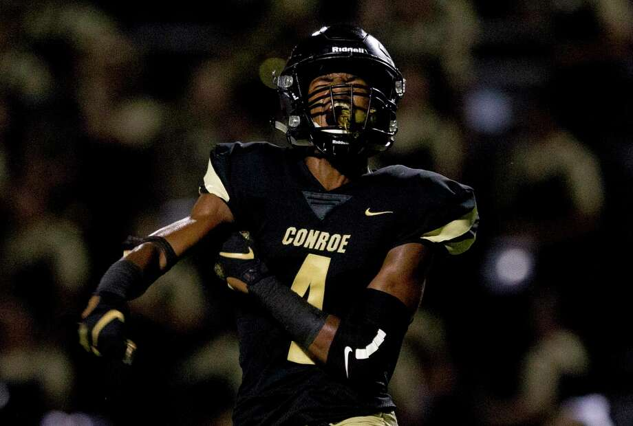 Conroe wide receiver Michael Phoenix (4) reacts after scoring a 14-yard touchdown to give the Tigers a 25-22 lead over Klein Oaks in the fourth quarter of a District 15-6A high school football game at Buddy Moorhead Stadium, Friday, Sept. 20, 2019, in Conroe. Photo: Jason Fochtman, Houston Chronicle / Staff Photographer / Houston Chronicle