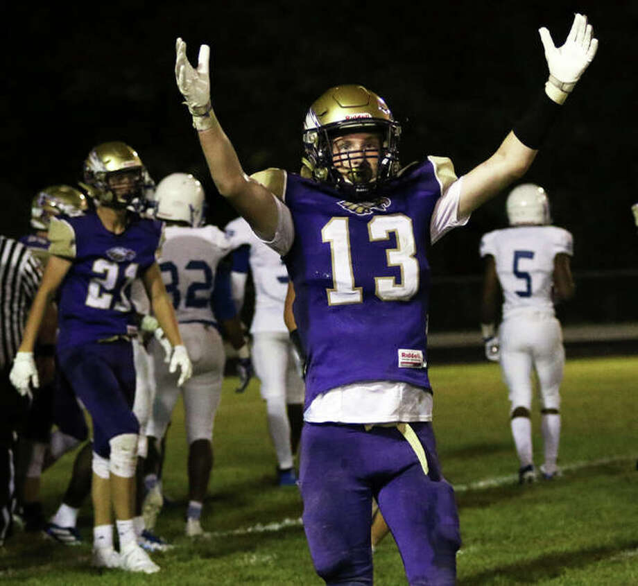 CM's Dillon Dublo (13) scored a TD with 1:03 left and helped lift the eagles to a 21-14 win Friday night at Jersey. He is shown signalling touchdown earlier this season against Cahokia. Photo: Nathan Woodside File | The Telegraph