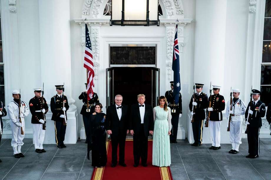 President Donald Trump and first lady Melania Trump stand with Australian Prime Minister Scott Morrison and his wife, Jennifer, before a state dinner in the Rose Garden of the White House on Friday evening. On the menu for the evening were sunchoke ravioli, Dover sole and an apple tart, and entertainment was slated to be performed by military musicians. Photo: Washington Post Photo By Jabin Botsford / The Washington Post