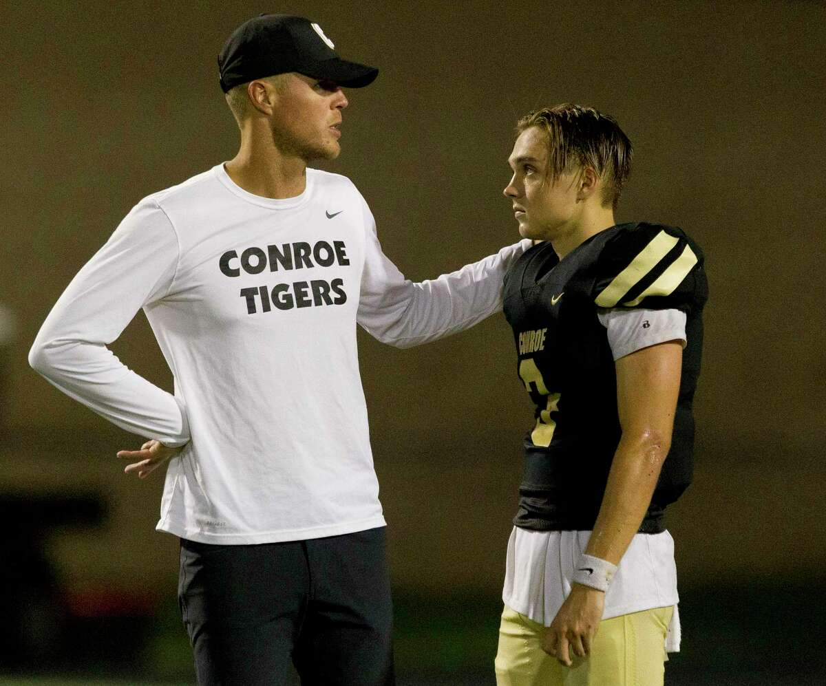 Conroe quarterback Christian Pack (3) talks with offensive coordinator Rhett Bomar after Klein Oak rallied to top the Tigers 29-25 during a District 15-6A high school football game at Buddy Moorhead Stadium, Friday, Sept. 20, 2019, in Conroe.