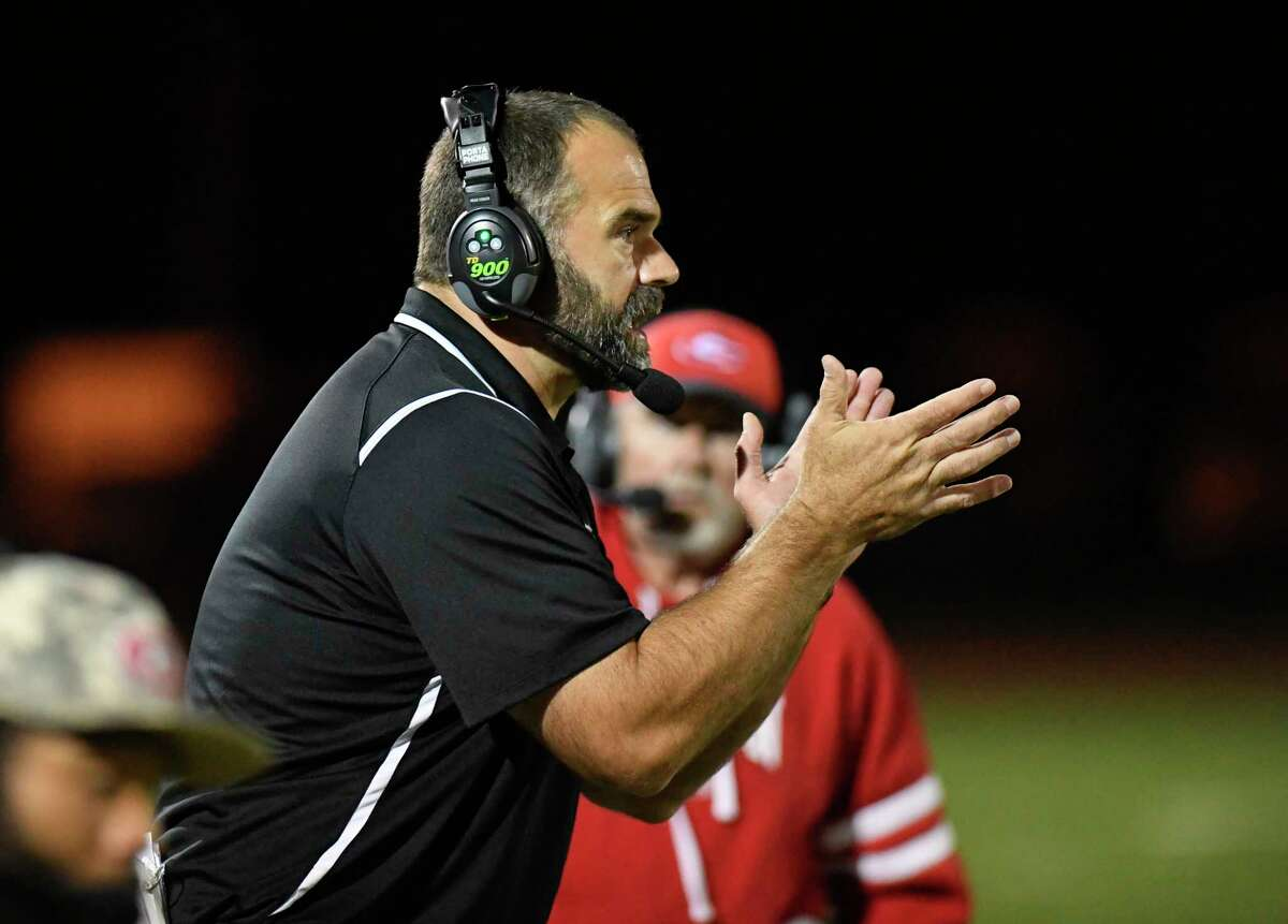 """Guilderland football coach Dan Penna is eager to try to defend his team's Class AA football title. """"I am knocking on wood right now, but I am looking forward to getting started Monday,"""" he said."""