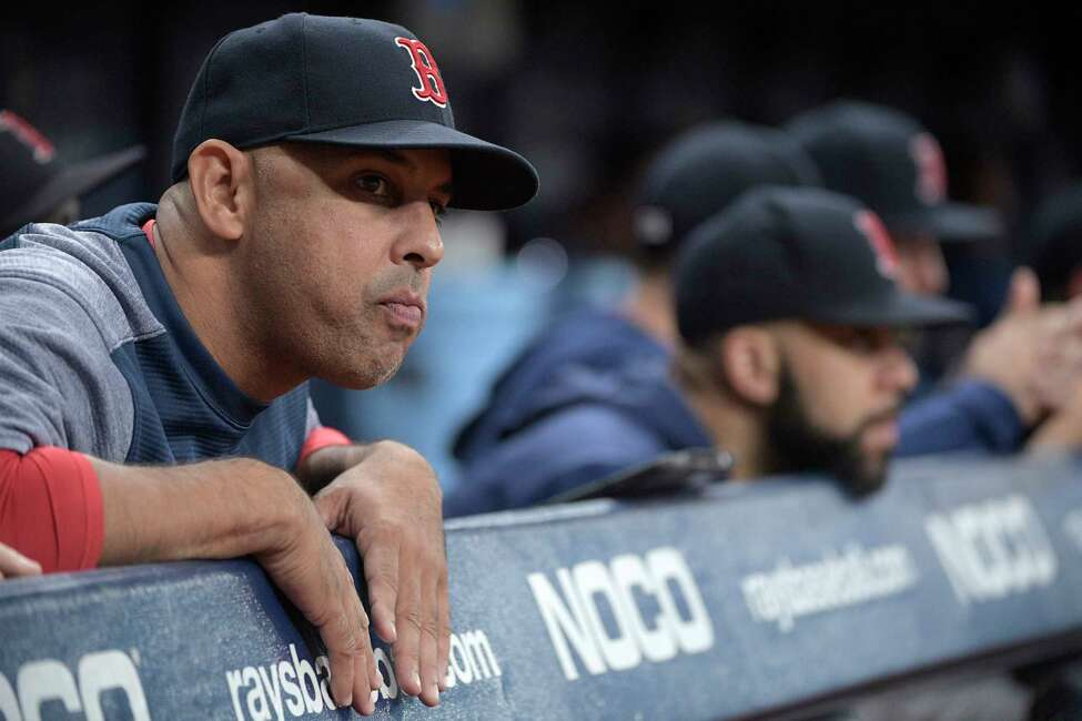 Boston Red Sox manager Alex Cora, left, watches from the dugout during the bottom of the eleventh inning of a baseball game against the Tampa Bay Rays, Friday, Sept. 20, 2019, in St. Petersburg, Fla. (AP Photo/Phelan M. Ebenhack)