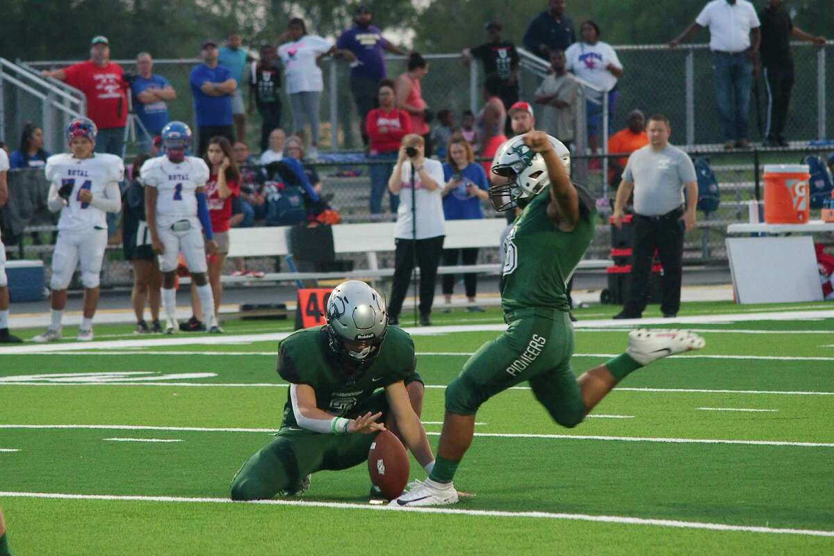 Lutheran South Academy's Luke Leblanc (3) holds as teammate Kevin Cordes (16) successfully kicks a 30-yard field goal against Brookshire Royal.
