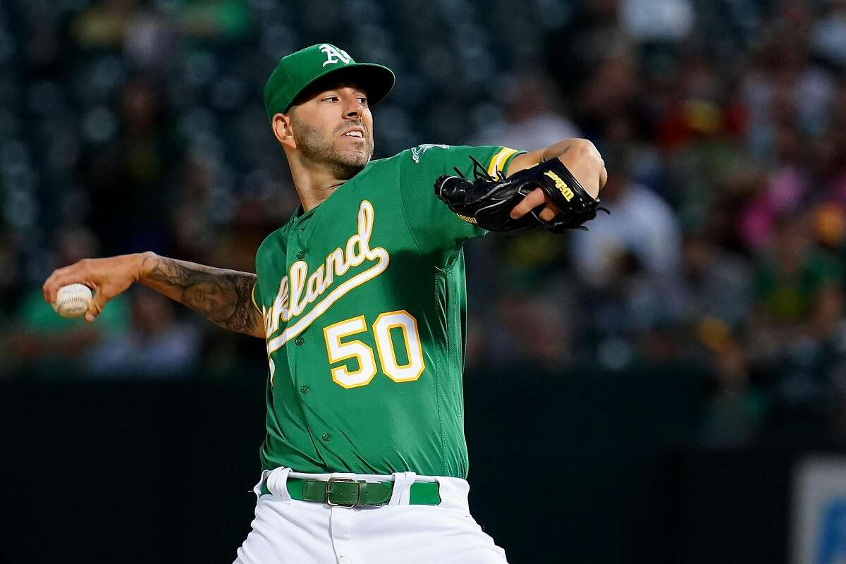 OAKLAND, CALIFORNIA - SEPTEMBER 20: Mike Fiers #50 of the Oakland Athletics pitches during the first inning against the Texas Rangers at Ring Central Coliseum on September 20, 2019 in Oakland, California. (Photo by Daniel Shirey/Getty Images)