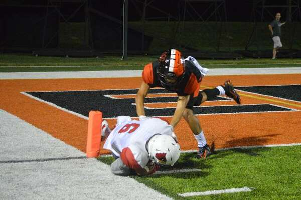 Alton wide receiver Xavier McNear, bottom, is stopped on the Edwardsville 1-yard line by EHS defensive back Ty Berumen during the third quarter of Friday's game.