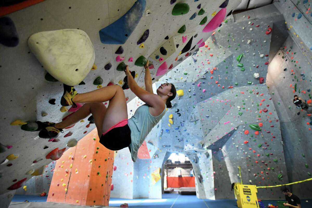 Annie Nelson, of Norwalk, climbs the overhanging section of the new boulder wall at Rock Climb Fairfield in the SportsPlex complex at 85 Mill Plain Road in Fairfield on Tuesday.